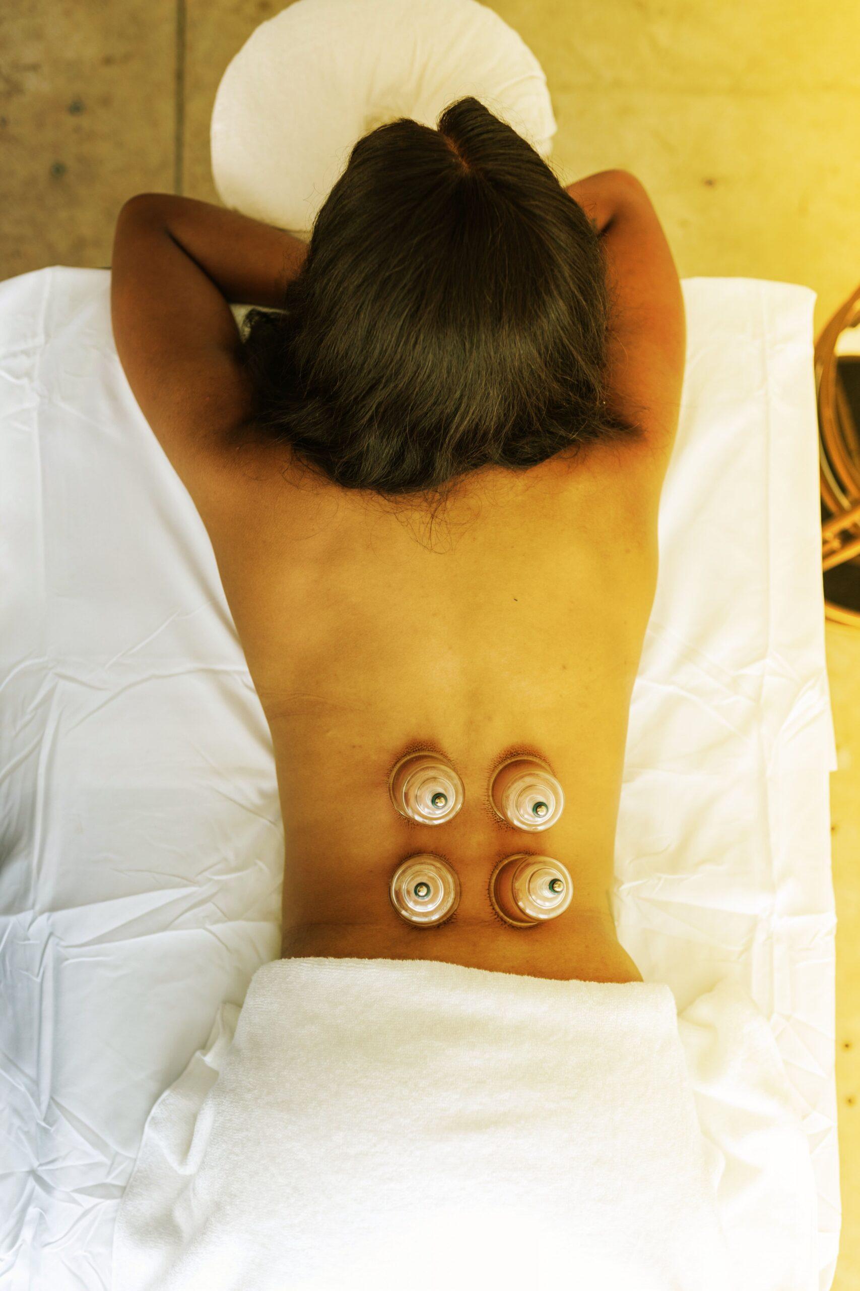Woman lying on back enjoying a massage